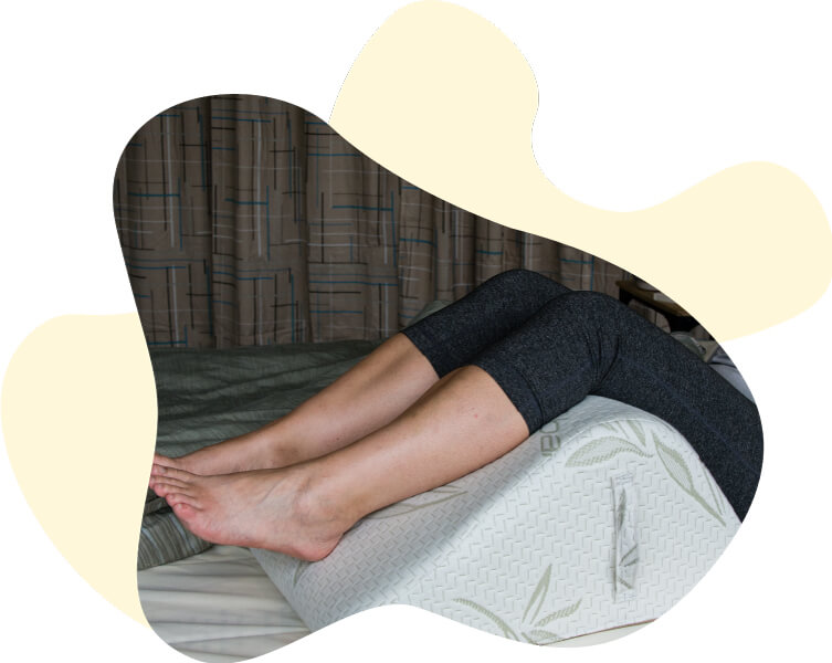 Woman resting her legs on the Body Buddy